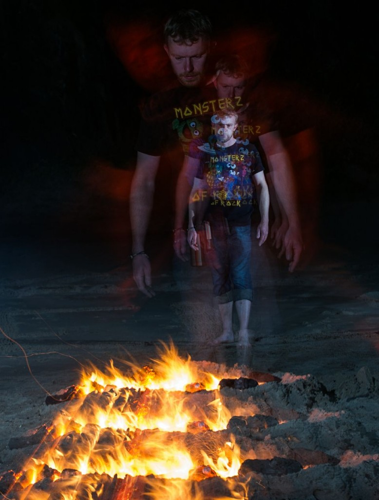Volunteer walking across Fire with FireWalking Ireland at Night